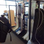 goalie bag and hockey stick display
