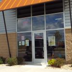 store exterior with orange awning